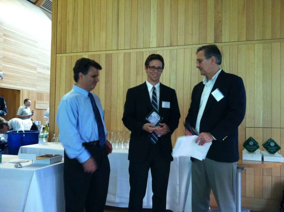 Submitted photo Michael Tyre, center, co-developer of CenterPoint Connecticut in Middletown, receives an Award of Merit from the CT Green Building Council on June 21 in New Haven. At left is Rick Warhall, chairman of CTGBC Board, and right, is Whitney Talcott, CTGBC board member.