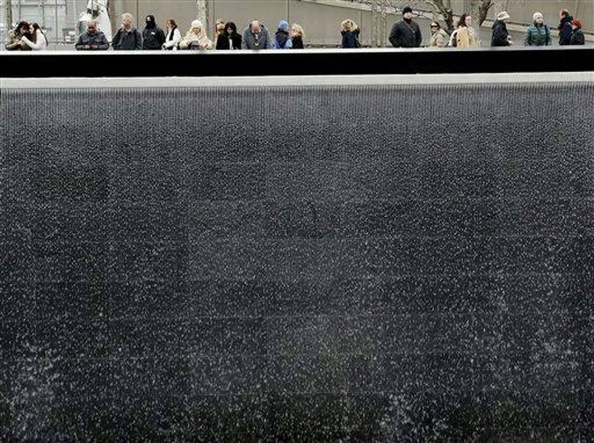 Visitors look over the waterfalls Monday at the National September 11 Memorial and Museum in New York. Associated Press