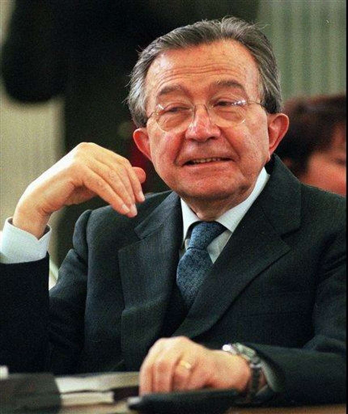 OBIT - In this Friday, Dec. 15, 1995 file photo, former Premier Giulio Andreotti reacts to a question, as he attends a court hearing of his trial, temporarily moved to Rome from Palermo. Italian state television said Monday, May 6, 2013, that Giulio Andreotti, Italy's former seven-time premier, has died at age 94. At his prime, Andreotti was one of Italy's most powerful men: he helped draft the country's constitution after World War II, sat in parliament for 60 years and served as premier seven times. Andreotti was hospitalized last year with heart problems stemming from a respiratory infection. (AP Photo/Massimo Sambucetti)