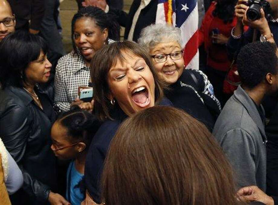 Robin Kelly celebrates her special primary election win for Illinois' 2nd Congressional District, once held by Jesse Jackson Jr., Tuesday, Feb. 26, 2013, in Matteson, Ill. After a primary campaign dominated by gun control and economic woes, voters chose Kelly over Debbie Halvorson and Anthony Beale, making her the likely replacement for Jesse Jackson Jr., three months after his legal troubles and battle with depression forced the son of the civil rights leader to resign from Congress. (AP Photo/Charles Rex Arbogast) Photo: AP / AP
