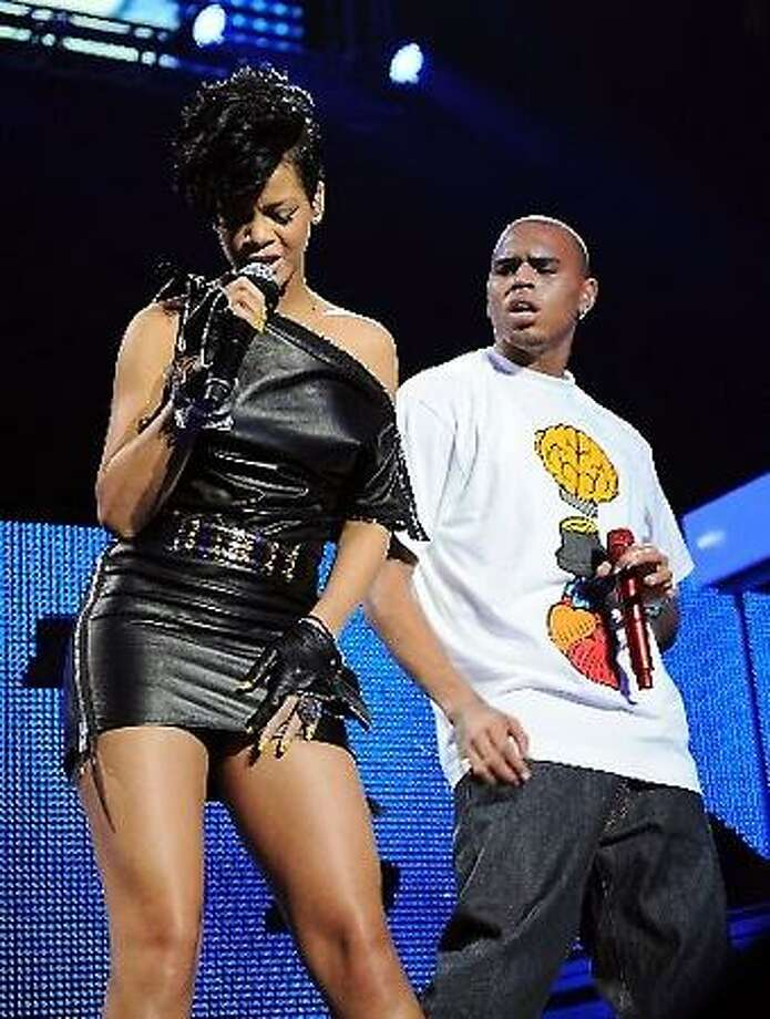 """In a Dec. 12, 2008 file photo singers Rihanna and Chris Brown perform at Madison Square Garden in New York. Brown, who was arrested a week ago in connection with a domestic violence investigation, said Sunday Feb. 15, 2009 he is """"sorry and saddened"""" by what happened. (AP Photo/Evan Agostini)"""