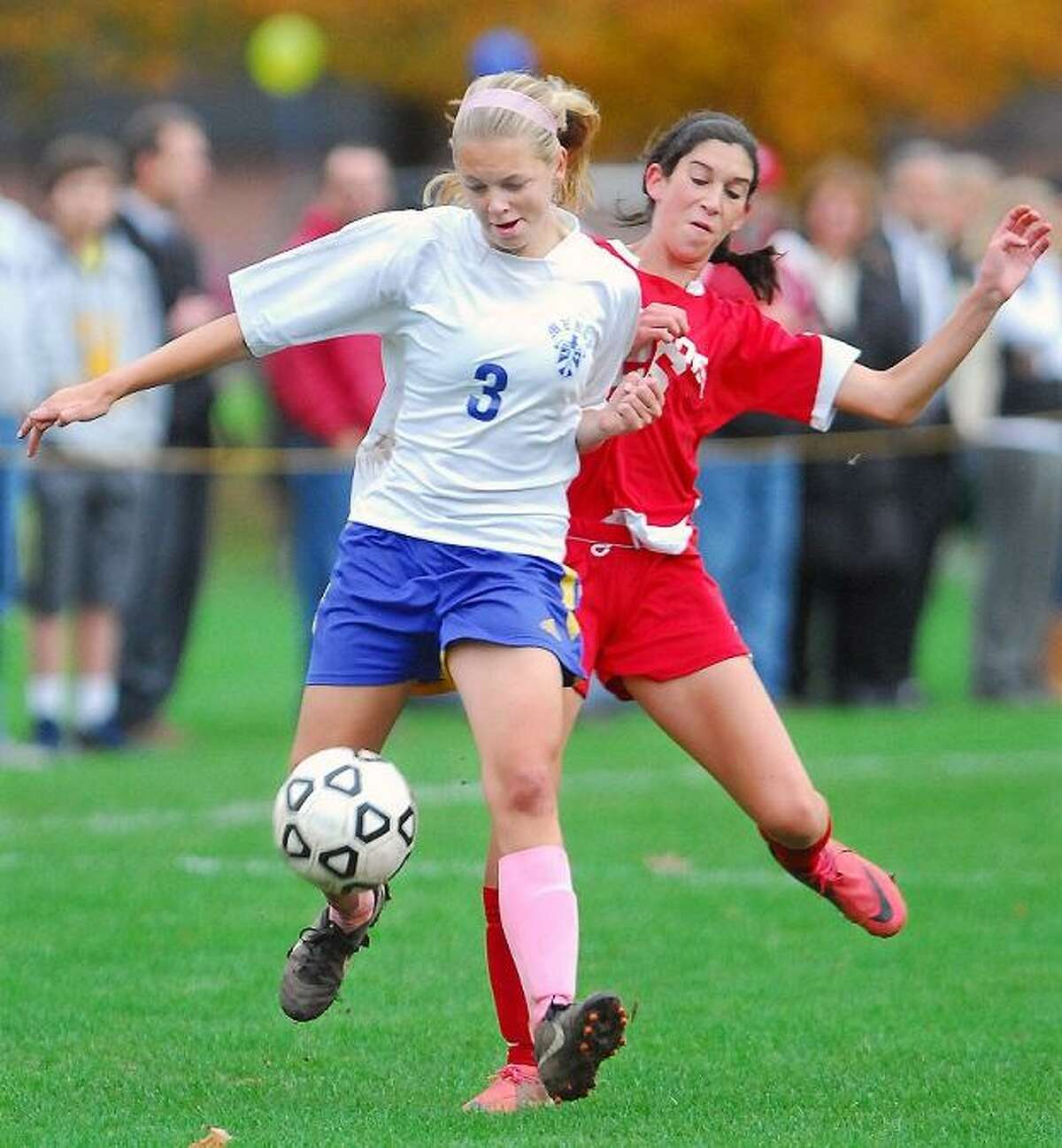 CATHERINE AVALONE/THE MIDDLETOWN PRESS Mercy midfielder Vicky Scott battles Branford's Sara Consolo in the second half of Wednesday's match in Middletown. Mercy won, 5-1.