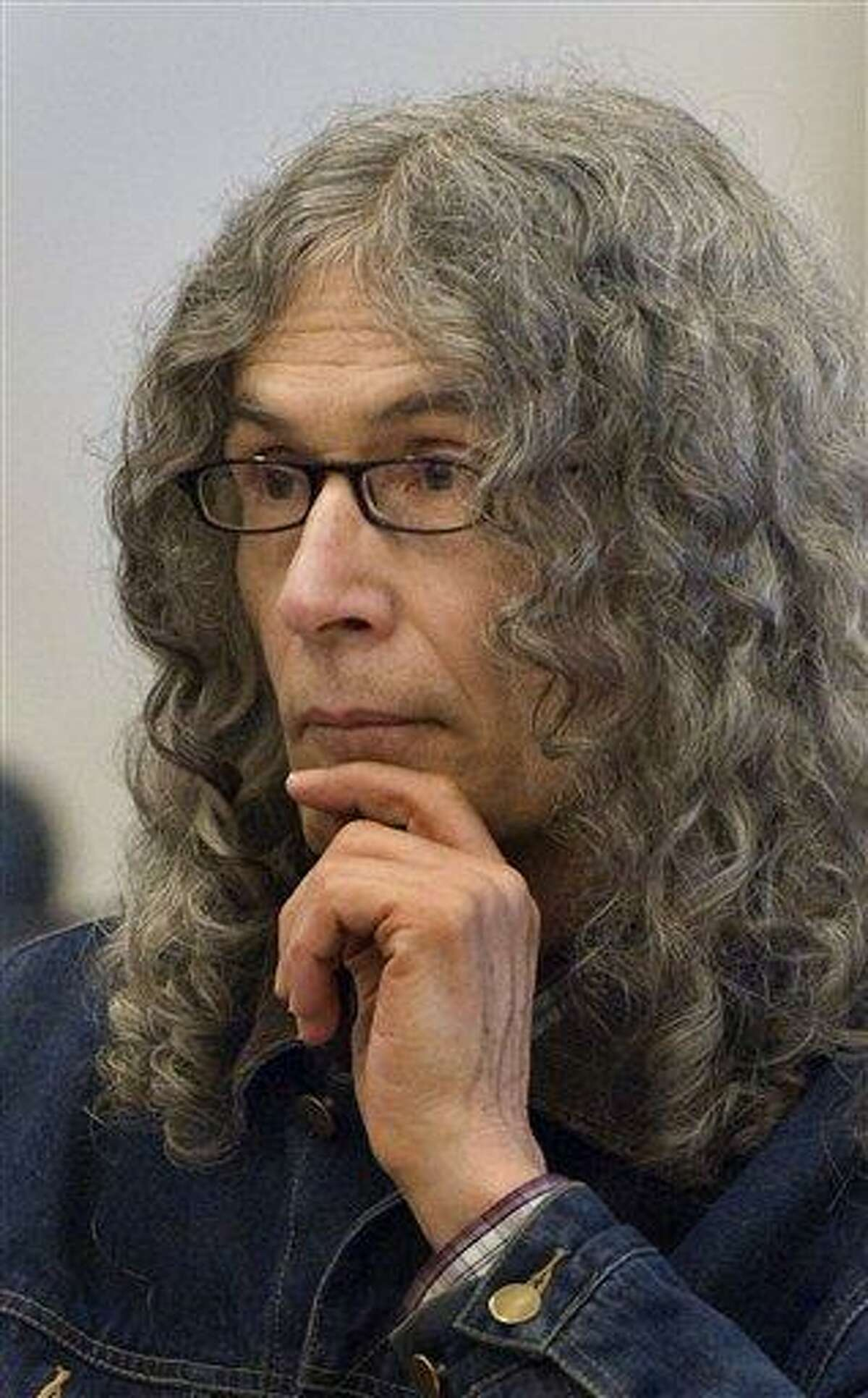 """In this 2010 file photo, convicted serial killer Rodney Alcala listens as victim-impact statements are read in a Santa Ana, Calif. On Wednesday, Alcala was headed to New York to face charges of killing two young women, Cornelia Crilley and Ellen Hover, in the 1970s, the Manhattan district attorney's office said. Alcala, a photographer and former """"Dating Game"""" contestant, has been on death row in California for the 1970s stranglings of four women and a 12-year-old girl. Associated Press"""