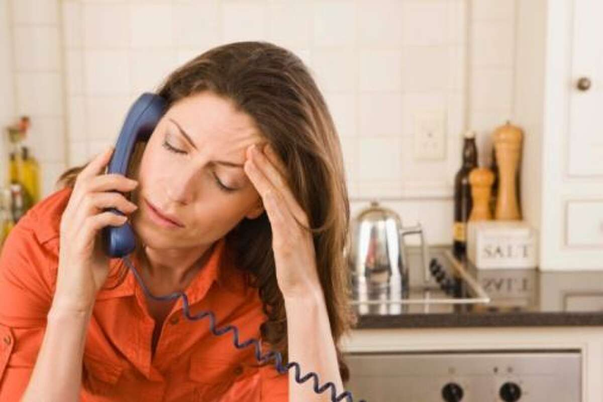 Distressed woman on telephone
