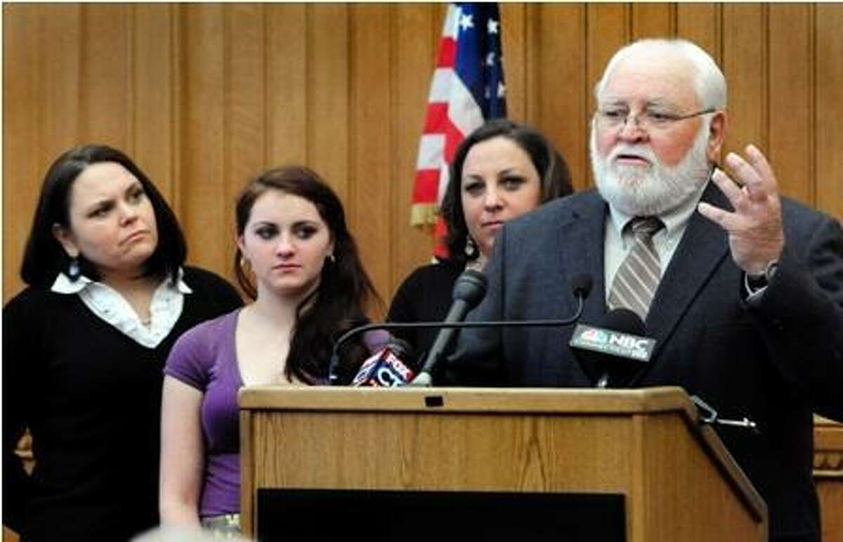 Robert Barnette, father of murder victim, Kathy Hardy, speaks at a Capitol press conference. Looking on, from left, are family members Jennifer Paul, Maggie Duddy and Dawn Duddy. Melanie Stengel/Register