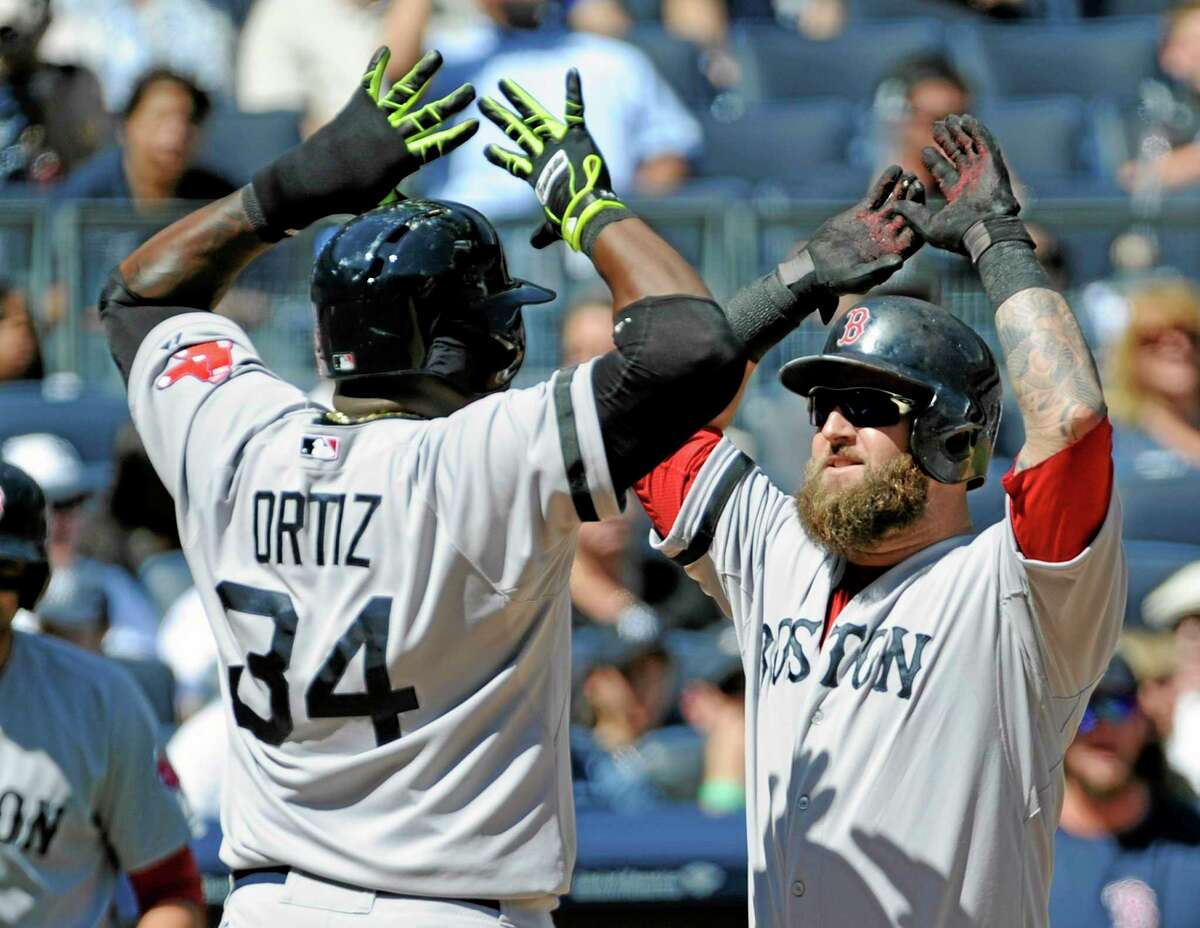 Boston's Mike Napoli, right, celebrates with David Ortiz after Napoli hit a two-run home run during the second inning against the Yankees Saturday.