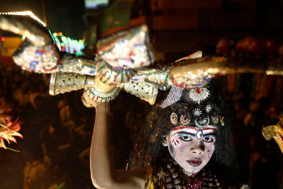 In this Monday, Oct. 22, 2012 photo, a young Indian artist dressed as Hindu god Shiva participates in a Dussehra procession in Allahabad, India. The Hindu festival of Dussehra commemorates the triumph of Lord Rama over the demon king Ravana, marking the victory of good over evil. (AP Photo/Rajesh Kumar Singh) Photo: AP / AP