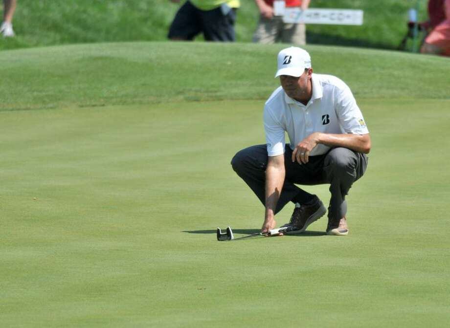 Matt Kuchar lines up a putt on hole number 10 during the opening round of the Travelers Golf Championship in Cromwell, CT.  Photo by Greg Vasil for the New Haven Register 062112.