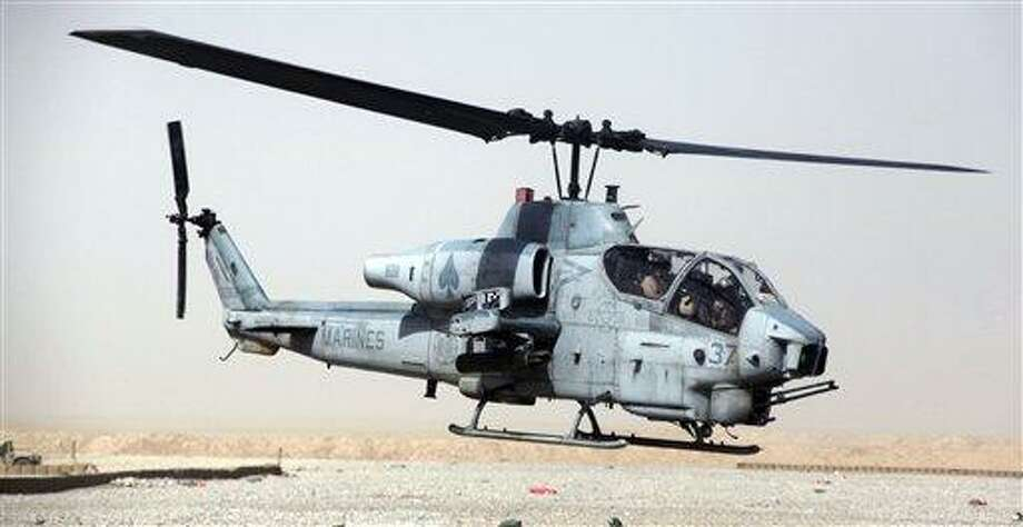 """This undated image provided by the US Marines shows a AH-1W """"Cobra"""" helicopter. Seven Marines were killed in a collision of two helicopters, one of them similar to this one, near Yuma, Ariz., during night training exercises, Wednesday. Associated Press Photo: ASSOCIATED PRESS / AP2012"""