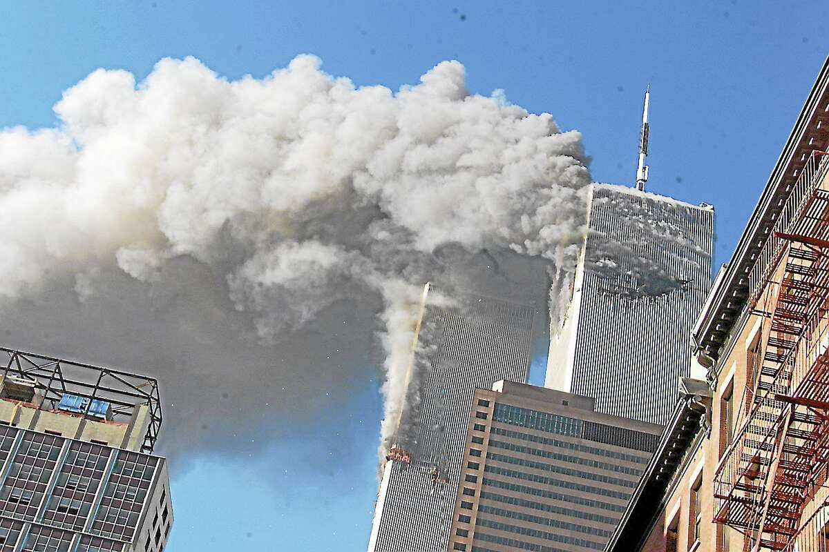 Richard Drew-File-The Associated PressFILE - This Sept. 11, 2001 file photo shows smoke rising from the burning twin towers of the World Trade Center after hijacked planes crashed into the towers, in New York City.