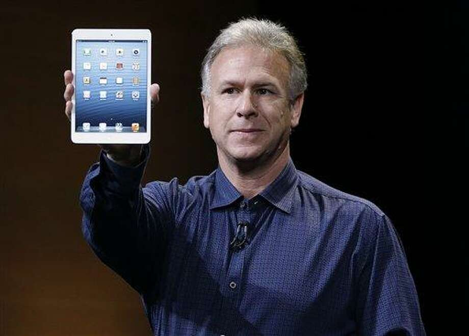 Phil Schiller, Apple's senior vice president of worldwide product marketing, introduces the iPad Mini Tuesday in San Jose, Calif. Associated Press Photo: AP / AP