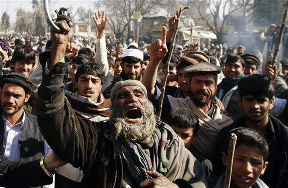 Afghans shout anti-U.S. slogans during a demonstration in Mehterlam, Laghman province east of Kabul, Afghanistan, Thursday. Afghan police on Thursday fired shots in the air to disperse hundreds of protesters who tried to break into an American military base in the country's east to vent their anger over this week's Quran burnings incident. Associated Press Photo: ASSOCIATED PRESS / AP2012