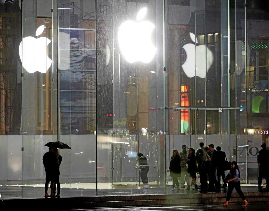 Pedestrians pass the Apple store location on fifth avenue Thursday, June 6, 2013, in New York. Photo: Frank Franklin II — The Associated Press  / AP