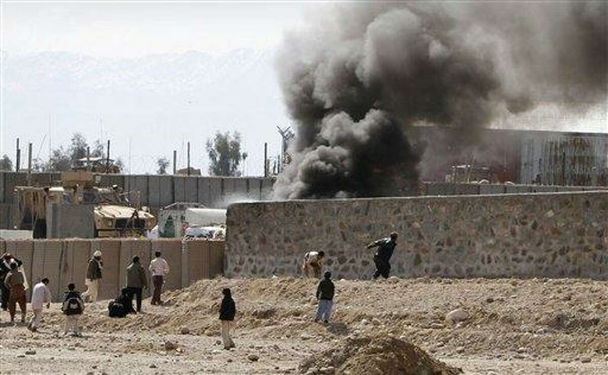 Smoke rises from an American military base during an anti-U.S. demonstration in Mehterlam, Laghman province east of Kabul, Afghanistan, Thursday. Associated Press