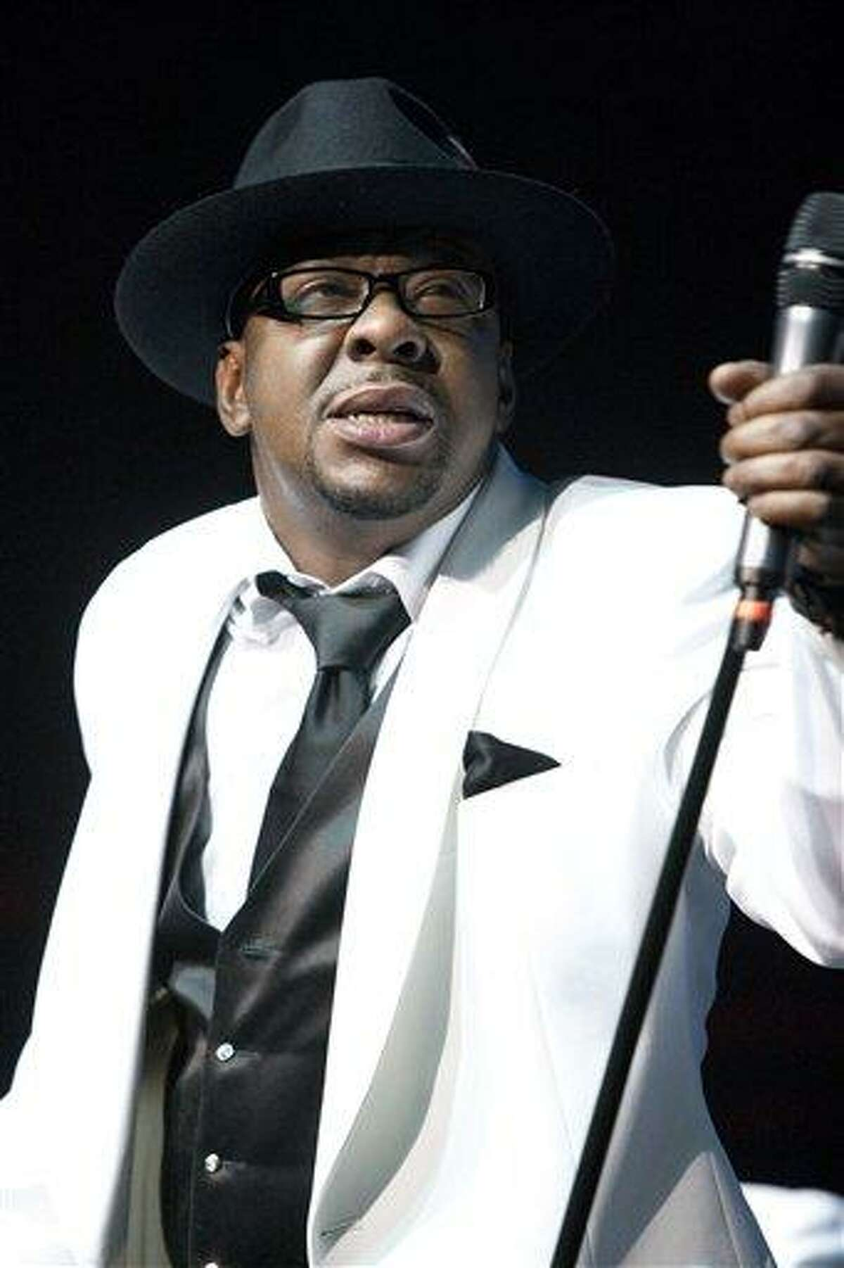 FILE - In this Feb. 18, 2012 file photo, singer Bobby Brown, former husband of the late Whitney Houston performs with New Edition at Mohegan Sun Casino in Uncasville, Conn. A judge sentenced Brown to 55 days in a Los Angelesjail Tuesday Feb. 26, 2013 after the singer pleaded no contest to a drunken driving charge and driving on a suspended license. (AP Photo/Joe Giblin, file)