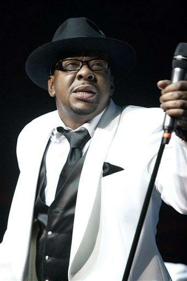 FILE - In this Feb. 18, 2012 file photo, singer Bobby Brown, former husband of the late Whitney Houston performs with New Edition at Mohegan Sun Casino in Uncasville, Conn. A judge sentenced Brown to 55 days in a Los Angeles jail Tuesday Feb. 26, 2013 after the singer pleaded no contest to a drunken driving charge and driving on a suspended license. (AP Photo/Joe Giblin, file) Photo: AP / AP