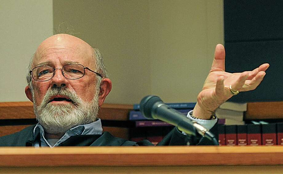 "FILE - This undated file photo shows District Judge G. Todd Baugh presiding at a hearing in Great Falls, Mont. A Montana judge has ordered a new sentencing hearing for a former teacher who received just 30 days in prison for raping a student who later killed herself. District Judge G. Todd Baugh said in Tuesday's order that a two-year mandatory minimum prison term for Rambold appears to be required under state law. Baugh has faced widespread condemnation from women's rights activists, elected officials and others for saying Rambold's 14-year-old victim was ""older than her chronological age."" He later apologized. Prosecutors had been considering an appeal, citing the two-year minimum requirement. But in a strange twist, Yellowstone County Attorney Scott Twito says Baugh may lack authority to impose such a sentence at this point. That's because state law says an illegal sentence must be handled through an appeal. (AP Photo/Billings Gazette, Larry Mayer, File) Photo: AP / Billings Gazette"