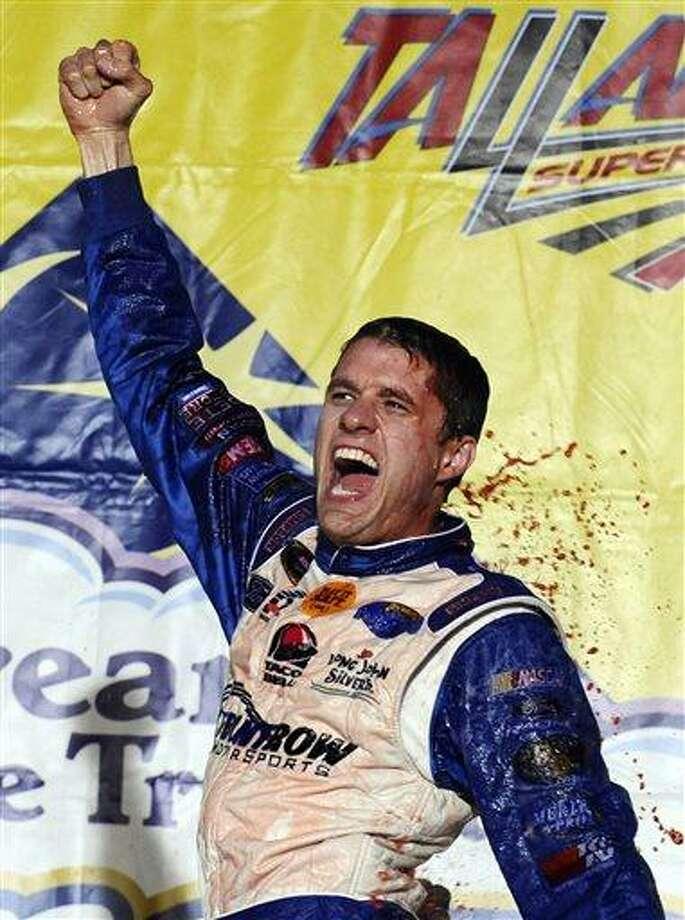 David Ragan celebrates after winning the NASCAR Sprint Cup Series Aaron's 499 auto race at Talladega Superspeedway in Talladega, Ala., Sunday, May 5, 2013. (AP Photo/Rainier Ehrhardt) Photo: AP / FR155191 AP