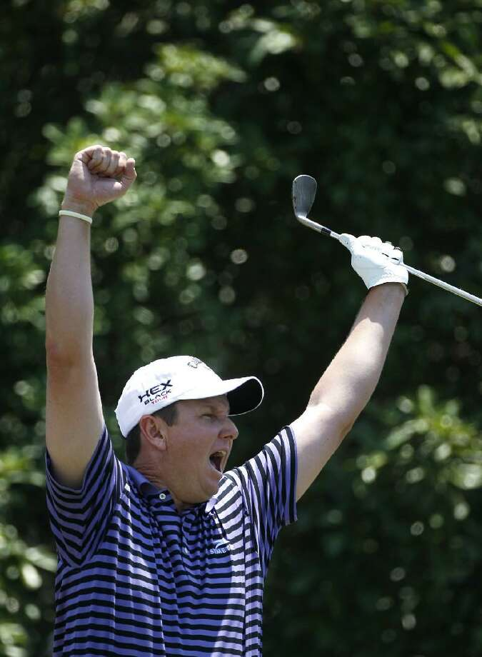 ASSOCIATED PRESS J.J. Henry celebrates his hole-in-one off the fifth tee during the final round of the PGA Byron Nelson Championship golf tournament on May 20 in Irving, Texas.