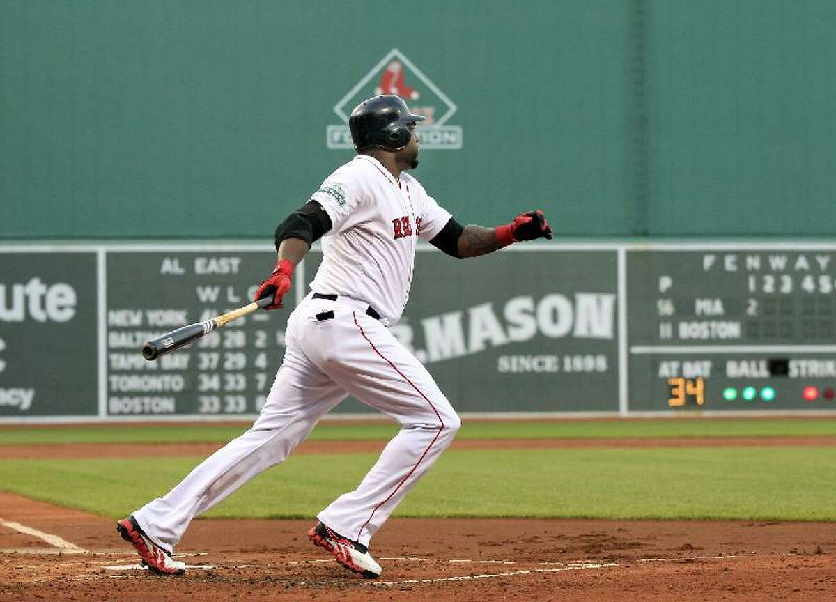 ASSOCIATED PRESS Boston Red Sox designated hitter David Ortiz follows through on a two-run homer against the Miami Marlins in the first inning of Tuesday night's game at Fenway Park in Boston. The Red Sox won 7-5.