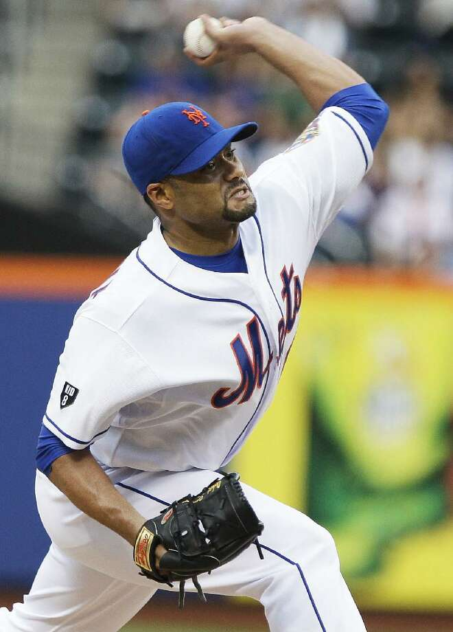 ASSOCIATED PRESS New York Mets starting pitcher Johan Santana delivers during the first inning of Tuesday's game against the Baltimore Orioles in Queens. The Mets won 5-0.