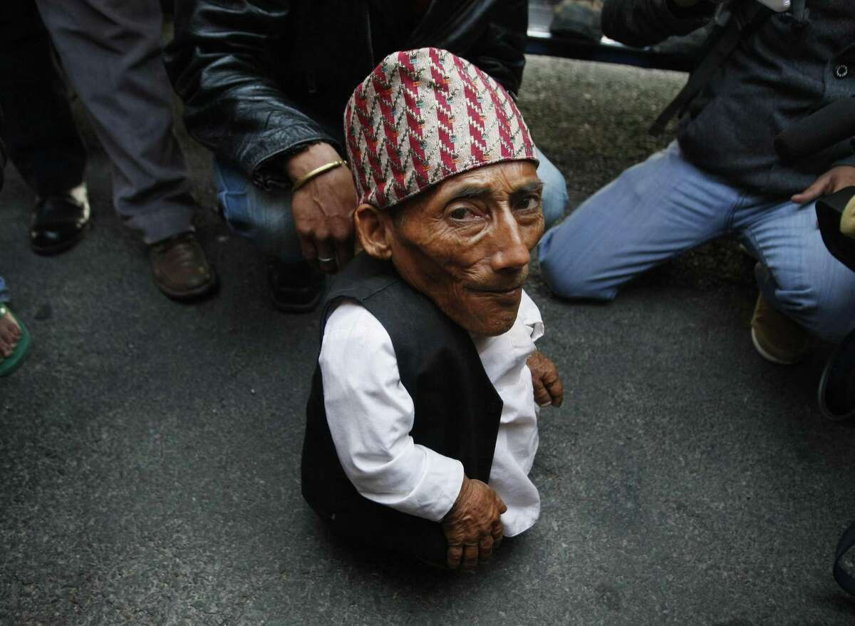 Dangi arrives at the airport in Katmandu, Nepal, Wednesday. Guinness World Records officials will be in Nepal this weekend to measure Dangi who hopes to be named the world's shortest man. (AP Photo/Binod Joshi)