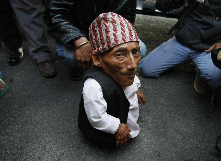 Dangi arrives at the airport in Katmandu, Nepal, Wednesday. Guinness World Records officials will be in Nepal this weekend to measure Dangi who hopes to be named the world's shortest man. (AP Photo/Binod Joshi) Photo: ASSOCIATED PRESS / AP2012