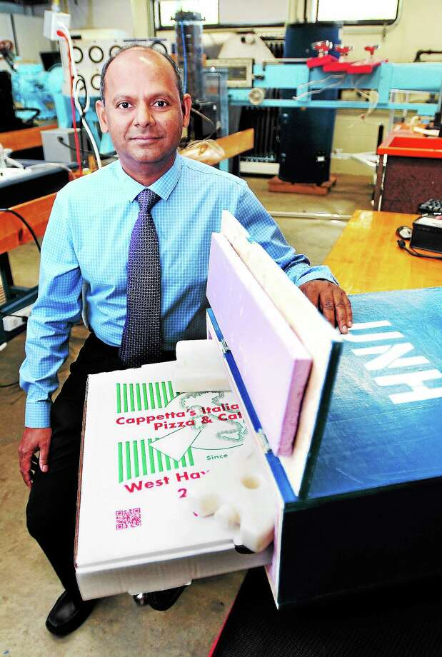 (Arnold Gold — New Haven Register)  Mechanical engineering professor Ravi Gorthala shows off a prototype pizza delivery box made by students at the University of New Haven's Buckman Hall in West Haven on 9/4/2013. Photo: Journal Register Co.