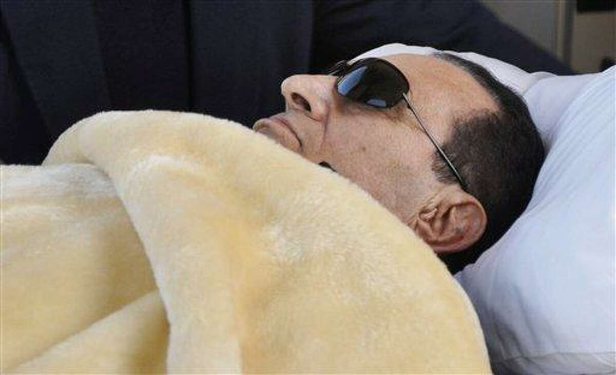 In this January file photo, former Egyptian president Hosni Mubarak is wheeled into court in Cairo, Egypt. Mubarak was in a coma on Wednesday but off life support and his heart and other vital organs were functioning, according to security officials. Associated Press