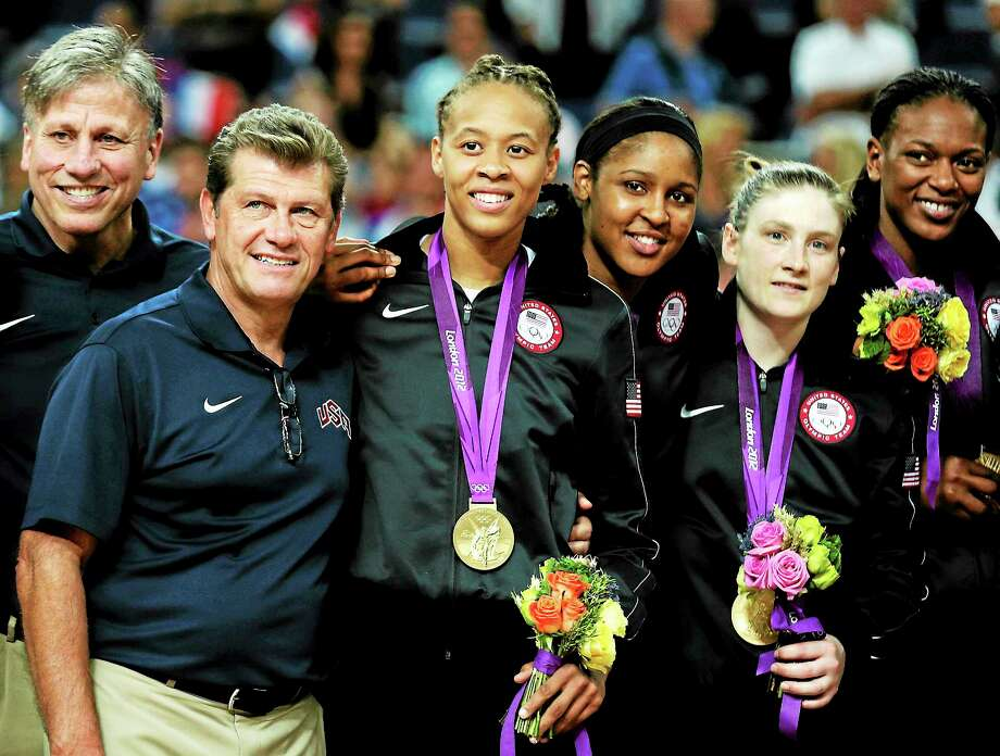 Charles Krupa — The Associated Press Geno Auriemma, posing here with his team after receiving their gold medals in 2012, was officially introduced as the U.S. coach through the 2016 Olympics on Friday. Photo: AP / AP2012