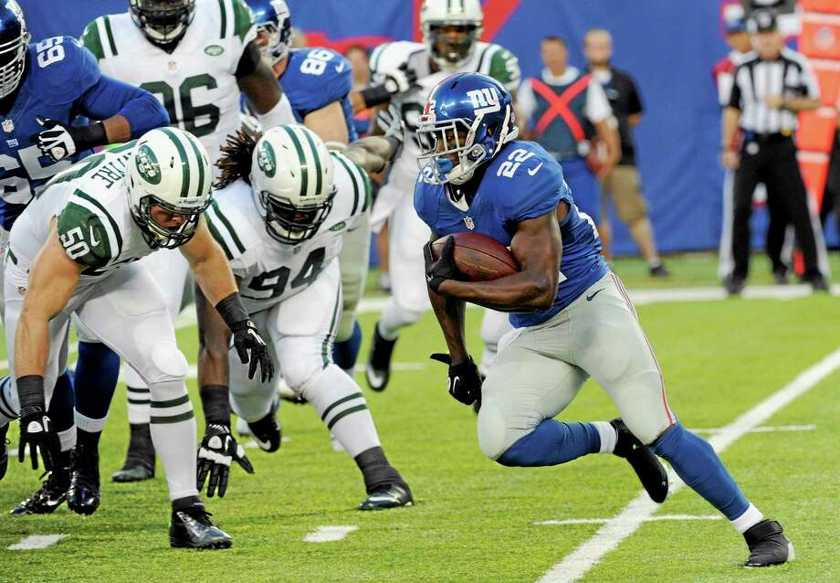 The Register's Dan Nowak has been a big proponent for Giants running back David Wilson this preseason. Photo: Bill Kostroun — The Associated Press  / FR51951 AP