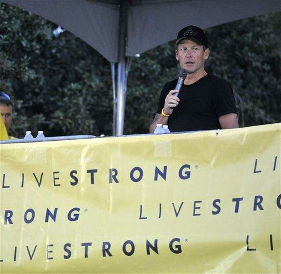 Lance Armstrong speaks at the Livestrong Challenge Austin bike ride Sunday. AP Photo/Michael Thomas Photo: AP / FR65778 AP