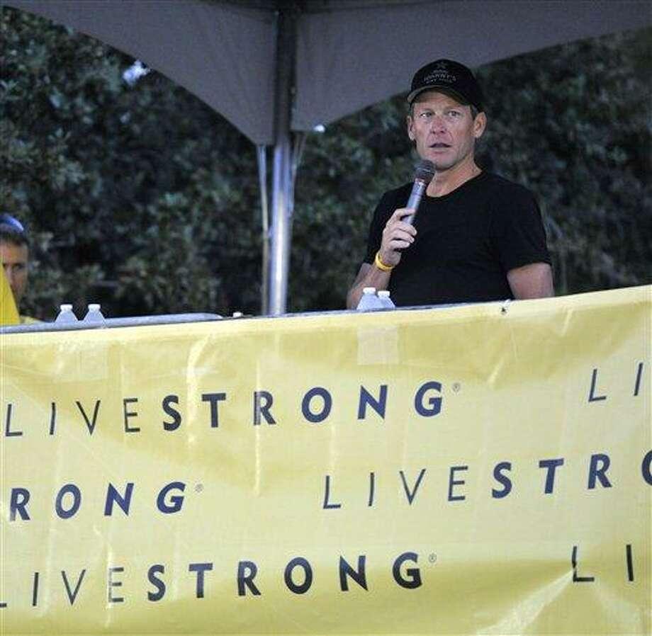 Lance Armstrong speaks at the Livestrong Challenge Austin bike ride Sunday. AP Photo/Michael Thomas Photo: AP / FR65778 AP