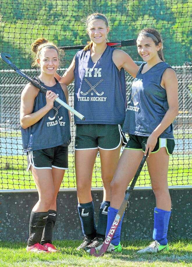 Haddam-Killingworth field hockey captains from left to right, seniors Allison Sheahan, Kiley Anderson and junior Kolby Burger. Photo: Catherine Avalone—The Middletown Press  / TheMiddletownPress