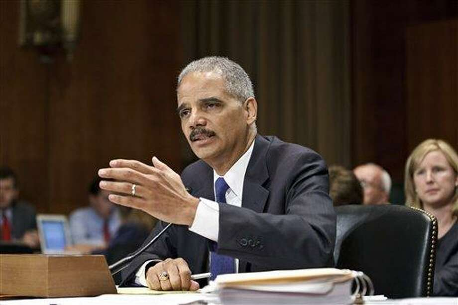 "Attorney General Eric Holder appears before the Senate Judiciary Committee on Capitol Hill in Washington, Tuesday. Holder is facing a contempt of Congress vote next week by the House Oversight Committee where he is accused of misleading the panel's investigation of the controversial ""Operation Fast and Furious"" gunrunning program.  Associated Press Photo: AP / The Associated Press"