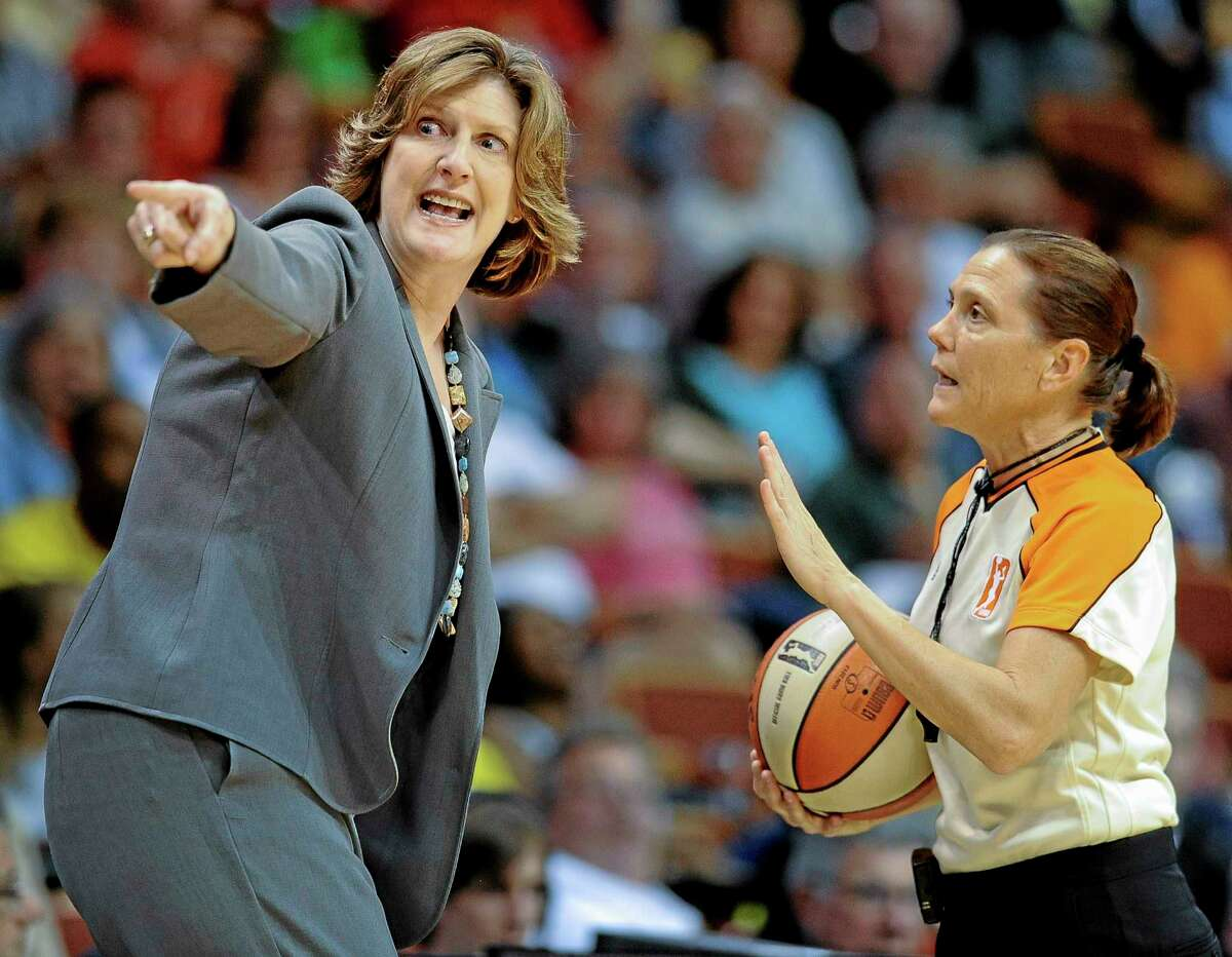 Connecticut Sun coach Anne Donovan gestures as she talks with official Sue Blauch during the second half of Friday's game. The Sun defeated the Washington Mystics 77-70.