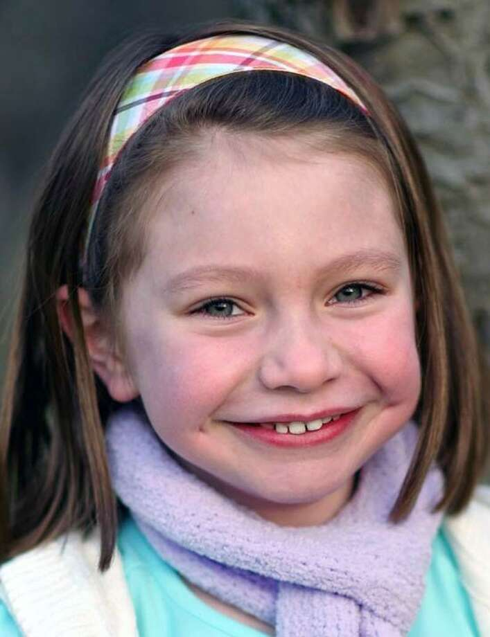 This Nov. 18, 2012 photo provided by John Engel shows Olivia Engel, 6, in Danbury, Conn. Olivia Engel. Olivia Engel, was killed Friday, Dec. 14, 2012, when a gunman opened fire at Sandy Hook Elementary School, in Newtown, Conn., killing 26 children and adults at the school. (AP Photo/Engel Family, Tim Nosezo) Photo: AP / Engel Family