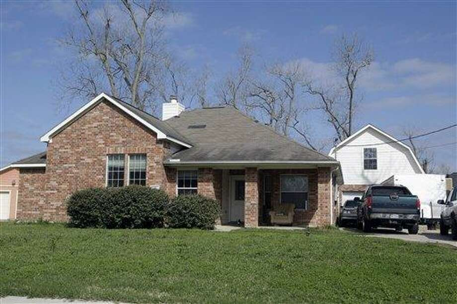 Eleven children, some of them reportedly found in restraints, were removed by children's protective services last month from this home in Dayton, Texas. Associated Press Photo: ASSOCIATED PRESS / AP2012