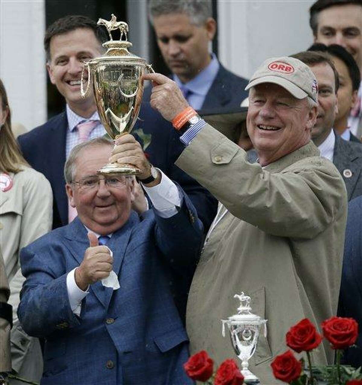 Orb owner Stuart Janney and trainer Claude McGaughey, left, celebrate after winning the 139th Kentucky Derby at Churchill Downs Saturday, May 4, 2013, in Louisville, Ky.(AP Photo/David Goldman)
