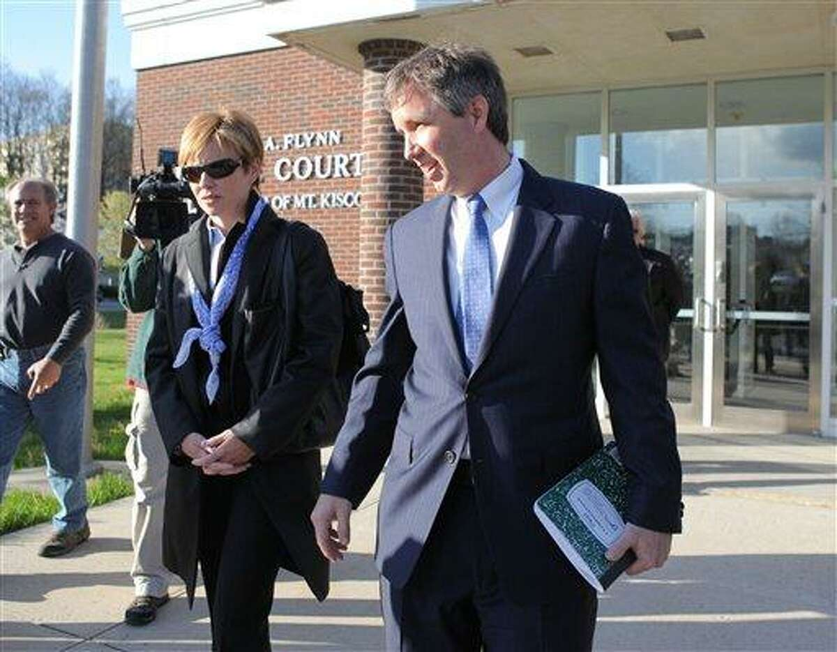 Douglas Kennedy, right, son of the late Sen. Robert F. Kennedy, arrives early to a locked door at village court in Mount Kisco. (AP Photo)