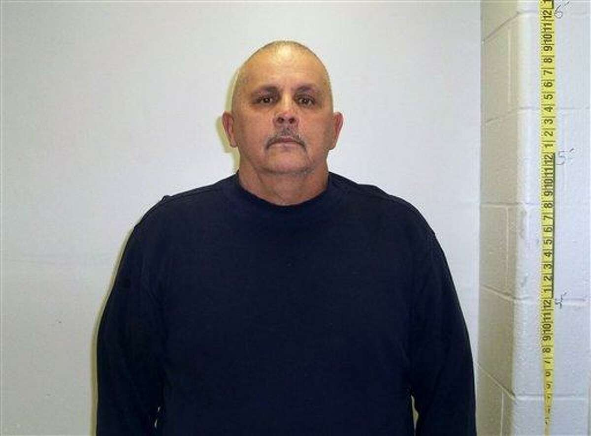 Victor Valcarcel, 64, is seen in this booking photo provided by the New Britain police department Thursday. Valcarcel was arrested late Wednesday about an hour after the shootings at the Hospital for Special Care, a long-term, acute-care facility in New Britain. Associated Press
