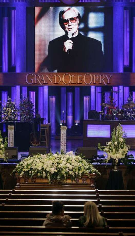 The casket for country music legend George Jones lies in the Grand Ole Opry House before his funeral on Thursday, May 2, 2013, in Nashville, Tenn. Jones, one of country music's biggest stars who had No. 1 hits in four separate decades, died April 26. He was 81. (AP Photo/Mark Humphrey, Pool) Photo: AP / AP POOL