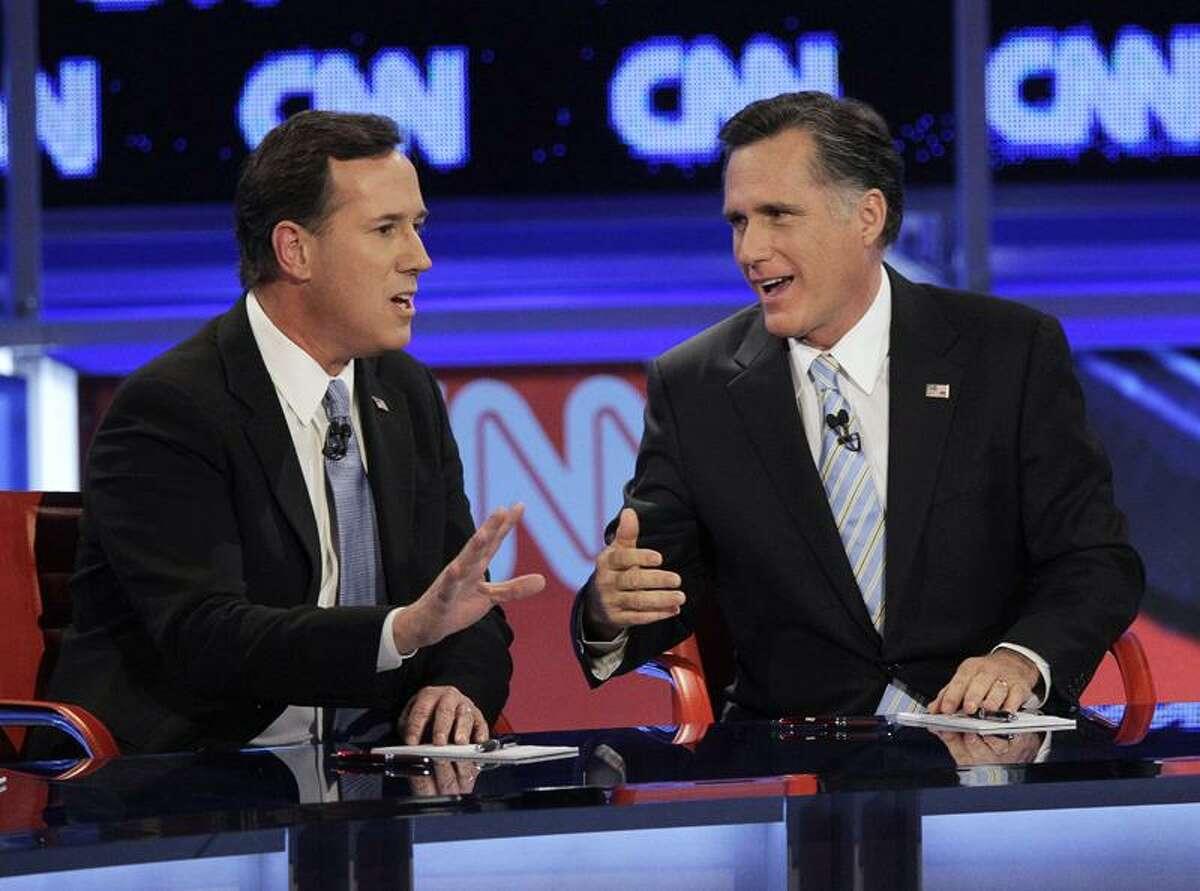 Republican presidential candidates, former Massachusetts Gov. Mitt Romney, right, and former Pennsylvania Sen. Rick Santorum argue a point during a Republican presidential debate Wednesday in Mesa, Ariz. Associated Press