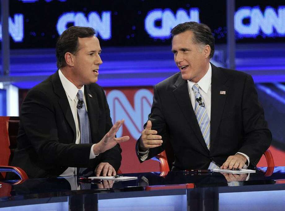 Republican presidential candidates, former Massachusetts Gov. Mitt Romney, right, and former Pennsylvania Sen. Rick Santorum argue a point during a Republican presidential debate Wednesday in Mesa, Ariz. Associated Press Photo: AP / Copyright 2012 The Associated Press. All rights reserved. This material may not be published, broadcast, rewritten or redistribu