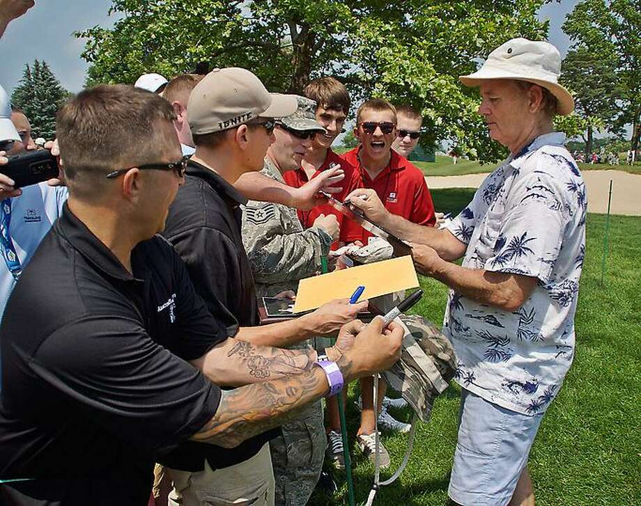 Cromwell--Actor Bill Murray signs autographs for members of the Air force who are stationed at Bradley during the Travelers Championship Celebrity Pro-Am. Peter Casolino/New Haven Register