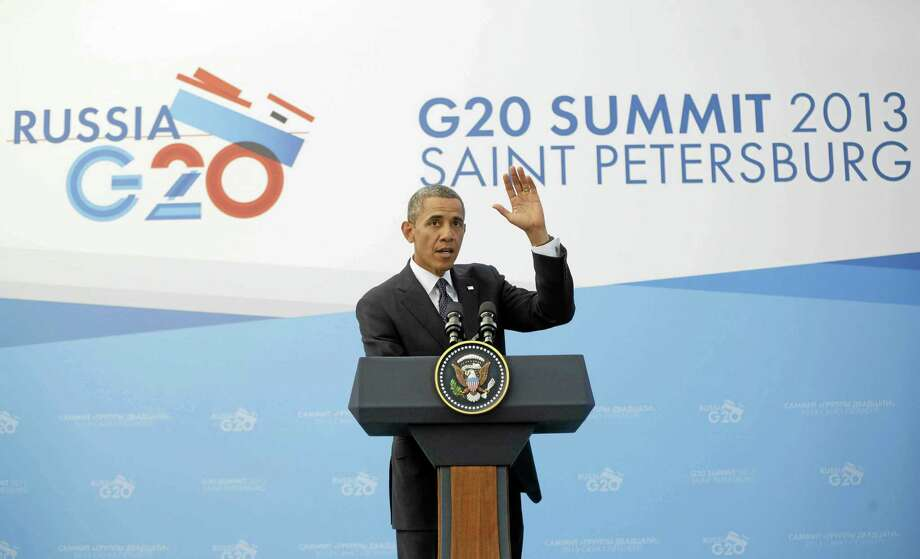 President Barack Obama waves at the end of his news conference at the G-20 Summit in St. Petersburg, Russia, Friday, Sept. 6, 2013. (AP Photo/Pablo Martinez Monsivais) Photo: AP / AP