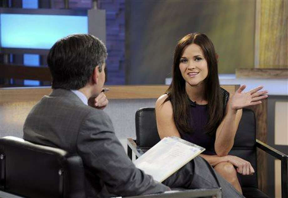 """This image released by ABC news shows co-host George Stephanopoulos, left, interviewing actress Reese Witherspoon on """"Good Morning America,"""" Thursday, May 2, 2013 in New York. During the interview, Witherspoon repeatedly apologized for her behavior during an April 19 traffic stop in Georgia. Witherspoon, 37, was arrested after the trooper said she wouldn't stay in the car while her husband, Hollywood agent Jim Toth, was given a field sobriety test. Toth was charged with drunken driving and is due in court May 23. Witherspoon faces a May 22 court hearing on the disorderly conduct charge. (AP Photo/ABC, Ida Mae Astute) Photo: AP / American Broadcasting Companies, Inc."""