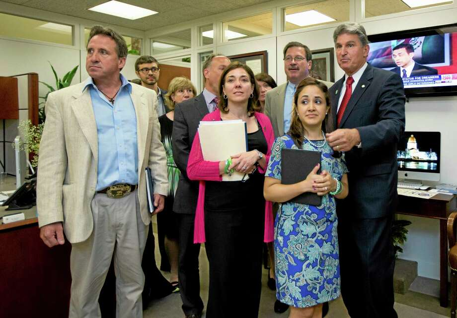 Sen. Joe Manchin, D-W.Va., right, meets with, from left, Neil Heslin, father of victim Jesse Lewis, Francine Wheeler, mother of victim Ben Wheeler, and Nelba Mawquez-Greene, mother of victim Ana Marquez-Greene, as Sandy Hook, Conn. Elementary School, families and friends of victims on Capitol Hill in Washington, Wednesday, June 12, 2013. The group joined policymakers and advocates on Capitol Building for a day-long event to remember the 26 children and educators tragically murdered last December in Newtown, Conn.  (AP Photo/Manuel Balce Ceneta) Photo: AP / AP