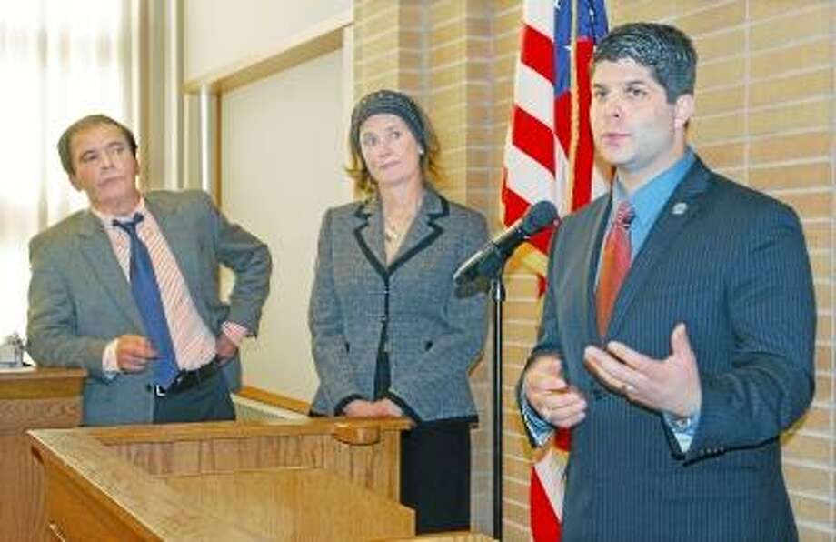CATHERINE AVALONE/THE MIDDLETOWN PRESS Mayor Daniel Drew held a press conference Monday afternoon in the Council Chambers at city hall announcing a settlement agreement between the Middletown Board of Education, the City of Middletown and Union Local 466 of Council #4 of AFSCME. Also pictured are Patricia Charles, superintendent of Middletown Public Schools and Eugene Nocera, left, chairman of the Board of Education.