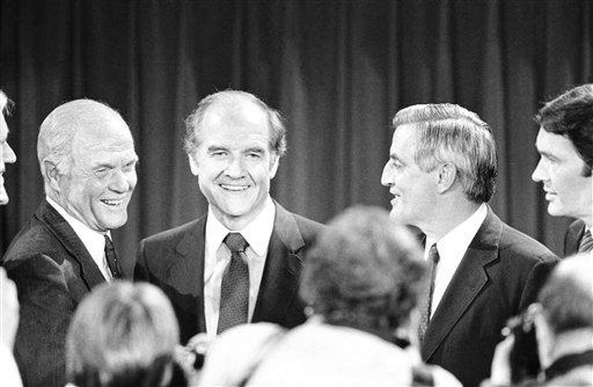 FILE - In this Oct. 13, 1983 file photo, Presidential hopefuls, Sen. John Glenn, left, former Sen. George McGovern, center, and former Vice-President Walter Mondale, right, pause for photographers after debating the nuclear arms issue at the Kennedy School of Government at Harvard University in Cambridge, Mass. A family spokesman says, McGovern, the Democrat who lost to President Richard Nixon in 1972 in a historic landslide, has died at the age of 90. According to the spokesman, McGovern died Sunday, Oct. 21, 2012 at a hospice in Sioux Falls, surrounded by family and friends. (AP Photo/Elise Amendola, File)